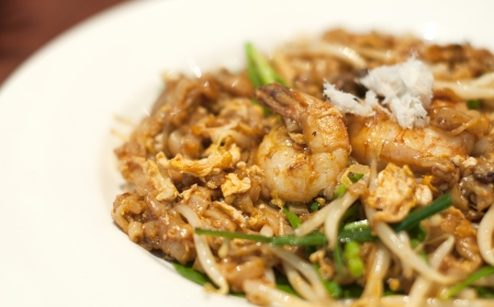 Fried Penang Char Kuey Teow which is a popular noodle dish in Malaysia, Indonesia, Brunei and Singapore photo