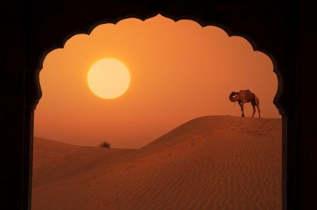 silhouette of arabic architecture on desert during a beautiful sunset photo