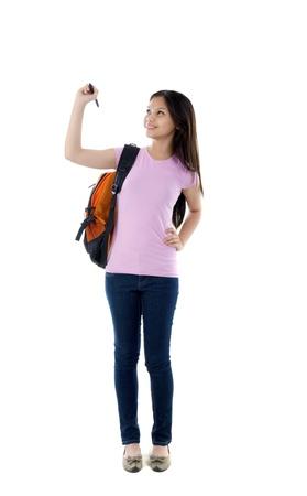 mixed race girl: mixed race young schoolcollege girl writing Stock Photo
