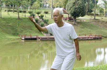 chi kung: asian senior performing taichi