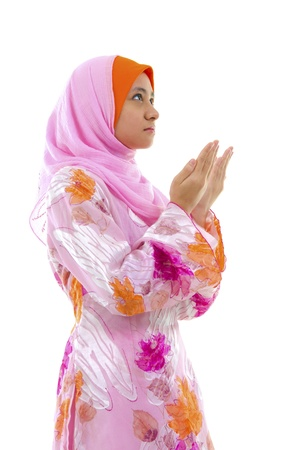 malay ethnicity: Female Muslim prayer on white background