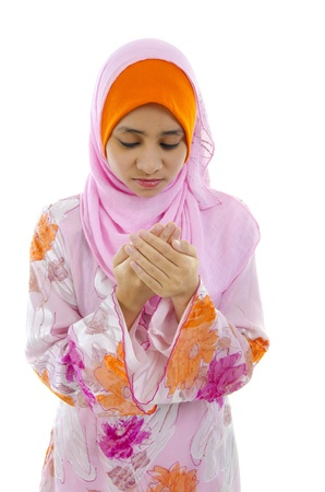 malay muslim girl praying with isolated white background photo