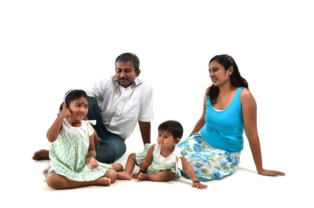 jeans skirt: Happy Indian family sitting on white background Stock Photo