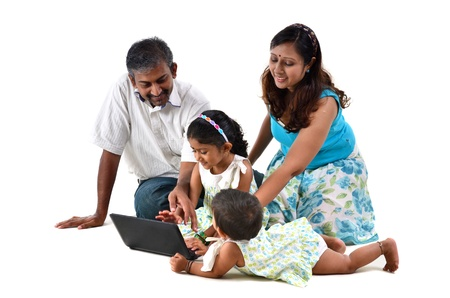 indian family on laptop Stock Photo - 14378845