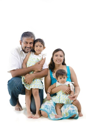 pakistani females: Happy Indian family sitting on white background  Stock Photo