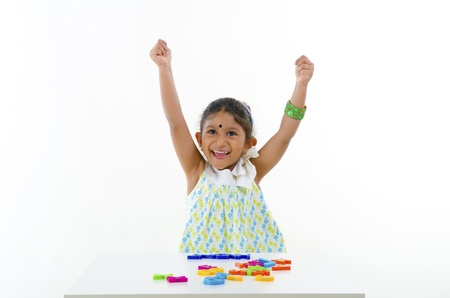 indian baby learning with alphabet blocks photo