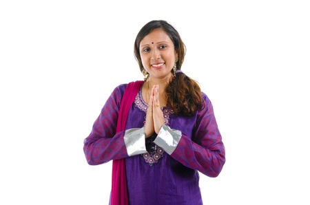 hand gestures: Mid Adult Indian woman in a greeting pose, isolated white background