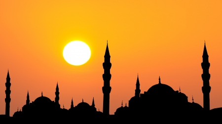 minarets: Hagia Sophia and The Blue Mosque  silhouette during sunset in Istanbul Turkey rahmadan concept photo  Stock Photo
