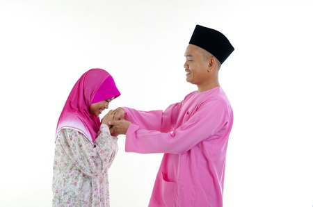 malay ethnicity: traditional malay greeting during hari raya festival
