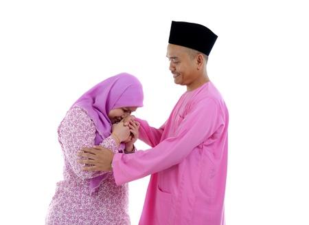 traditional malay greeting during raya festival Stock Photo - 14657726
