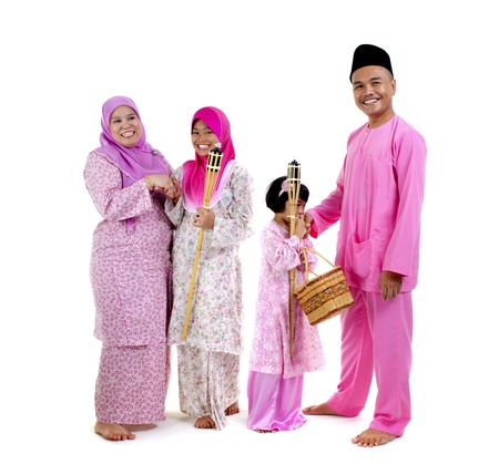 traditional malay family during hari raya occaion photo