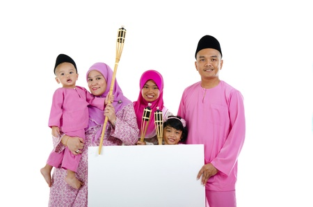 aidilfitri: asian malay family during raya with blank cardboard