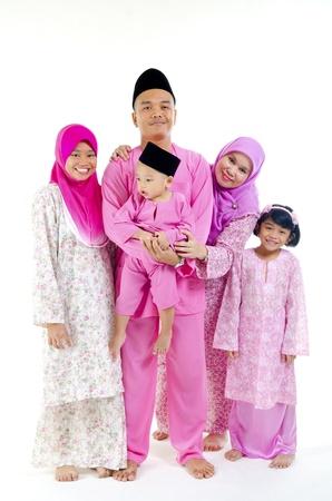traditional malay family during hari raya occaion  photo