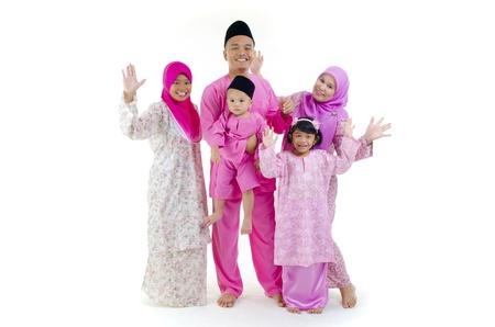 salam: traditional malay family during hari raya occaion