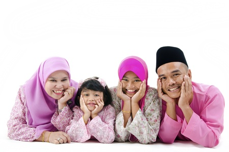 aidilfitri: malay family in traditional malay clothing