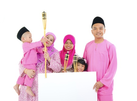 asian malay family during raya with blank cardboard  photo