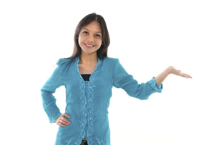 malay ethnicity: malay girl with hands up for advertising concept purpose Stock Photo