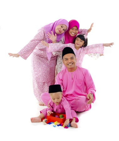 hari raya: traditional malay family during hari raya occaion