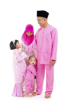 malay family during hari raya  aidilfitri, salam photo