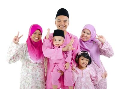 malay family in traditional malay clothing  photo