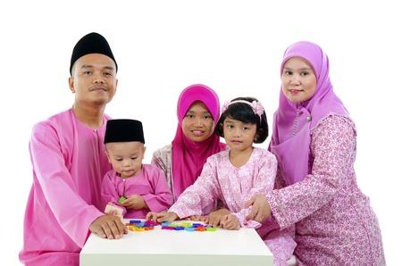 salam: malay family during hari raya  aidilfitri having fun with toys