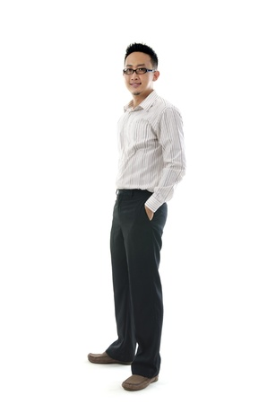 Full body of a smiling young Asian executive standing against isolated white background  photo
