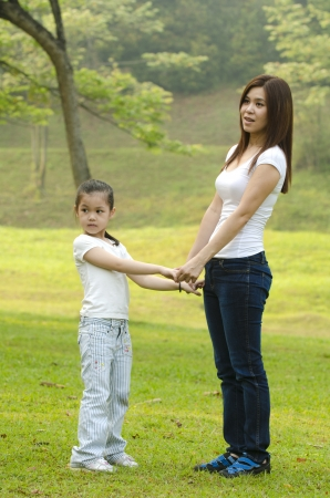asian mother and daughter full body, holding hands photo