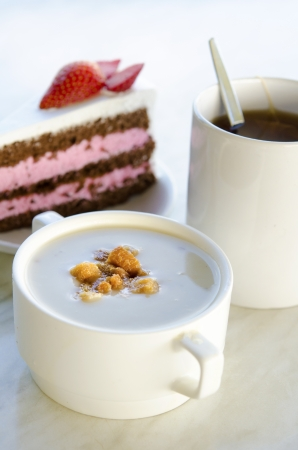 creamy mushroom soup with cake and coffee photo