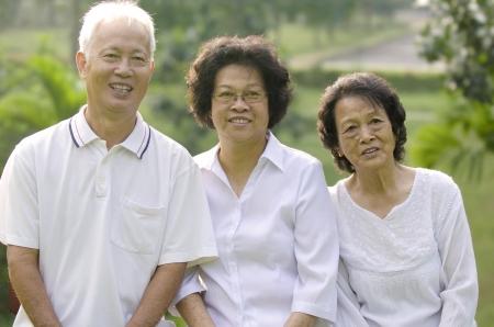Three Senior Asian Smiling happily at park in a morning photo