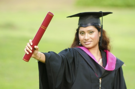 south asian girl graduation, focus on mortarboard Stock Photo - 14977593