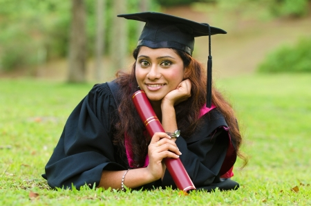 indian female graduate laying  photo