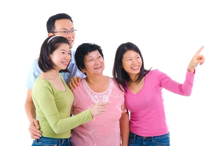 happy asian family pointing at somewhere photo