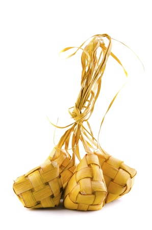compressed rice: Traditional Malay compact glutinous rice called Ketupat for celebrations  Stock Photo