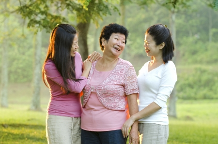 asian mother and bot her daughters photo