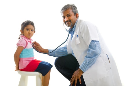 doctor appointment: asian indian doctor with a young girl,medical check