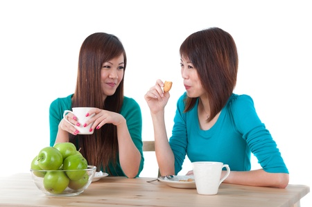 asian girls eating on table photo