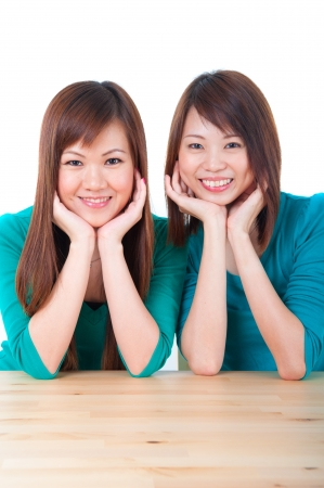side table: asian girls on a table Stock Photo