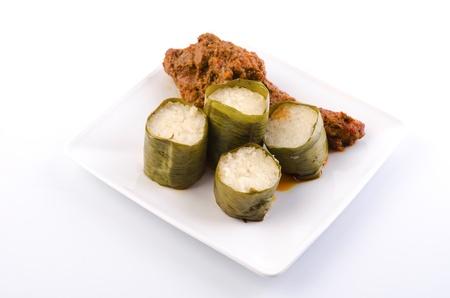 Traditional malay cuisine of glutinous rice lemak lemang and rendang ayam