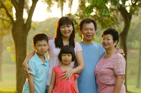 large family: Extended family standing outdoors smiling  Stock Photo