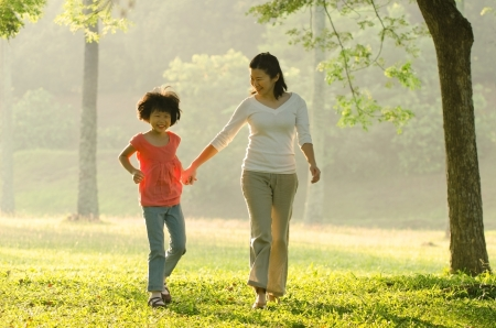 asian mother and daugther  walking in the park Stock Photo - 15044304