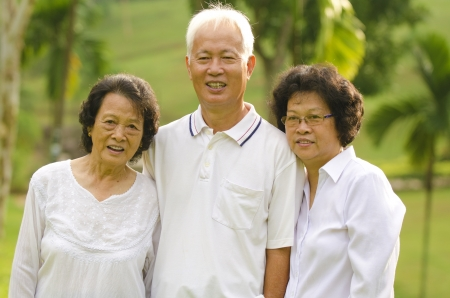 friendship day: Three Senior Asian Smiling happily at park in a morning  Stock Photo