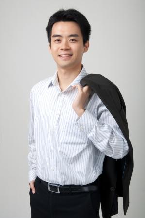 suit coat: asian male holding coat