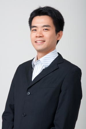 confident looking asian business man in a suit Stock Photo - 15174377