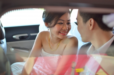 asian wedding couple candid shot during their actual day wedding ,focus on brides eyes  photo
