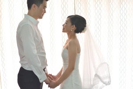 bridal couple: asian bride during their actual day wedding ,focus on brides eyes