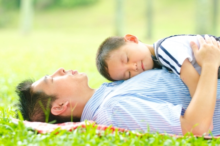 two parents: asian father bonding with his son Stock Photo
