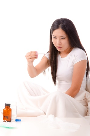 sick asian girl with high fever ,isolated on white photo