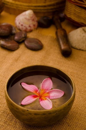 tropical spa setup with  frangipani flower photo