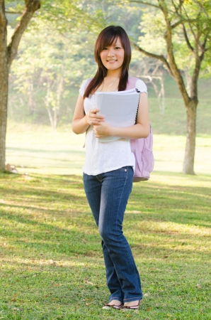 mixed race people: asian female college girl at outdoor Stock Photo