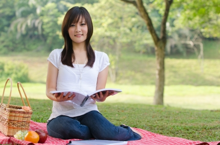 sitting on the ground: asian college girl sitting  Stock Photo